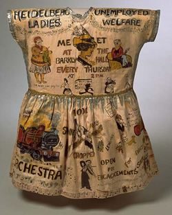 Girl's fancy dress garment, hand-painted with cartoons and caricatures showing the work of the Heidelberg Unemployment Bureau.