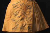 Detail of gold coloured netball skirt