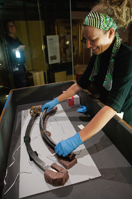 Installing Governor Lachlan Macquarie's sword in the Landmarks gallery.