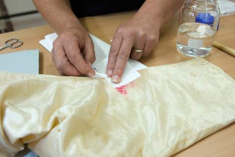 Test solutions are applied with a cotton swab and absorbed with acid-free blotter.