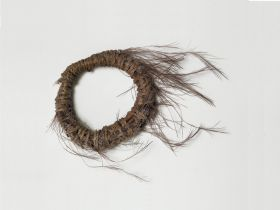 Feather wreath made of bird feathers (the feathers are badly damaged).