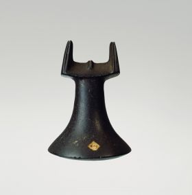 Pounder made from a single piece of black basalt with polished finish. The object consists of a pounding surface, neck and a head part.