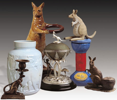 Collection of objects, from left: a brass kangaroo candestick; blue ceramic jug with kangaroo motifs; ceramic kangaroo umbrella stand; emu egg mounted in sterling silver and topped with a silver kangaroo; sculptured kangaroo atop a plinth with 'Ruby' at the base; a clay sculpture of a kangaroo.