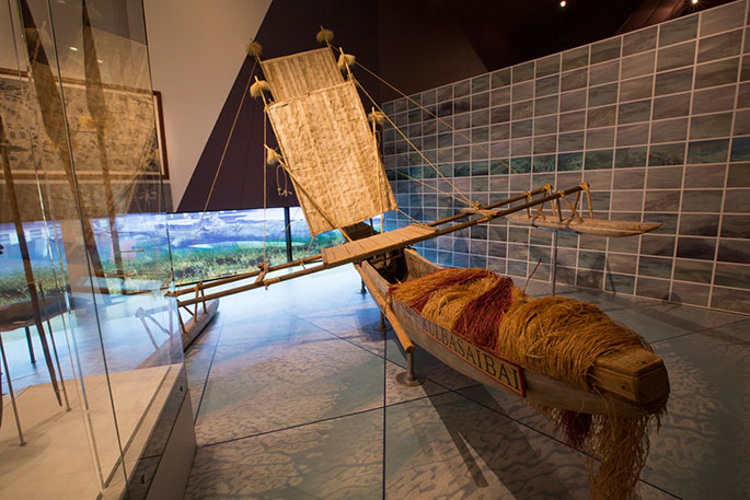 A canoe made of wood, bamboo, rope, plant fibre and metal.