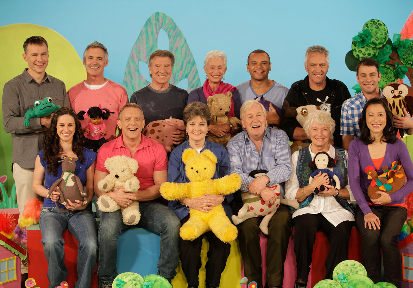 A group shot of Play School presenters and toys on set.