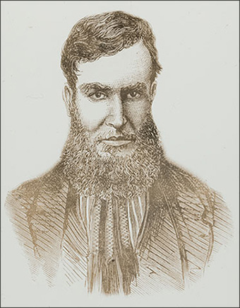 Portrait of young man with beard. He appears menacing.