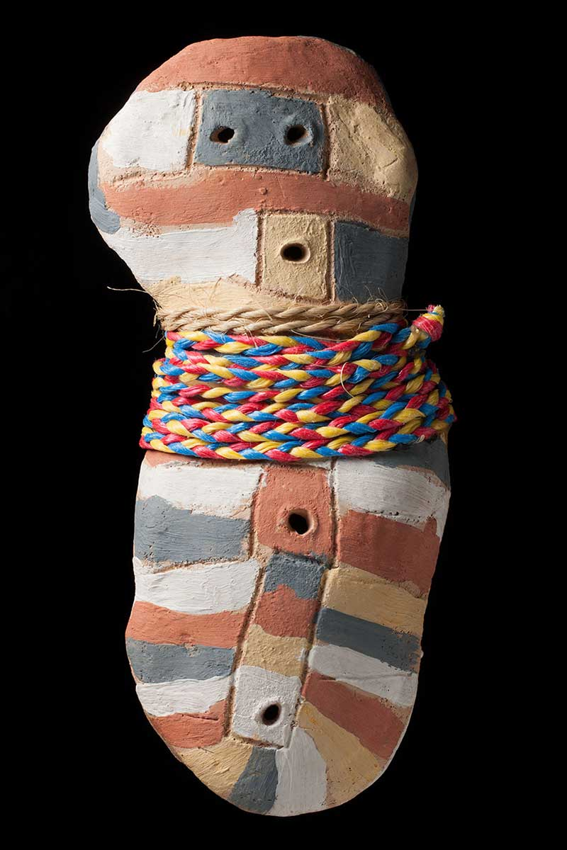 A photo of a painted clay sculpture. - click to view larger image