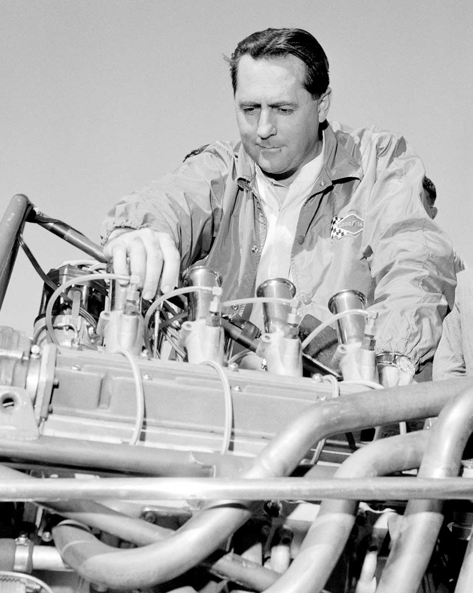 Jack Brabham checks his Repco–Brabham engine before the start of an international event at Surfers Paradise, Queensland, 1966 - click to view larger image