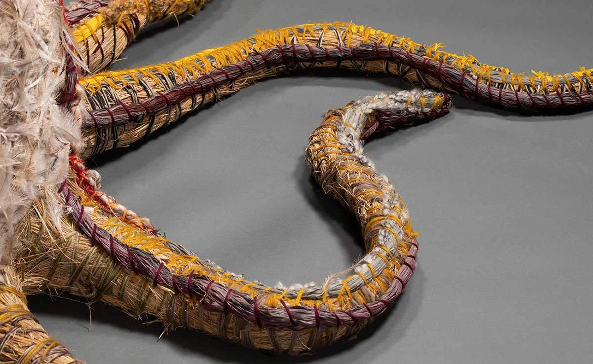 Detail image featuring two curvy roots from a tree sculpture made from plant-based and synthetic materials. - click to view larger image