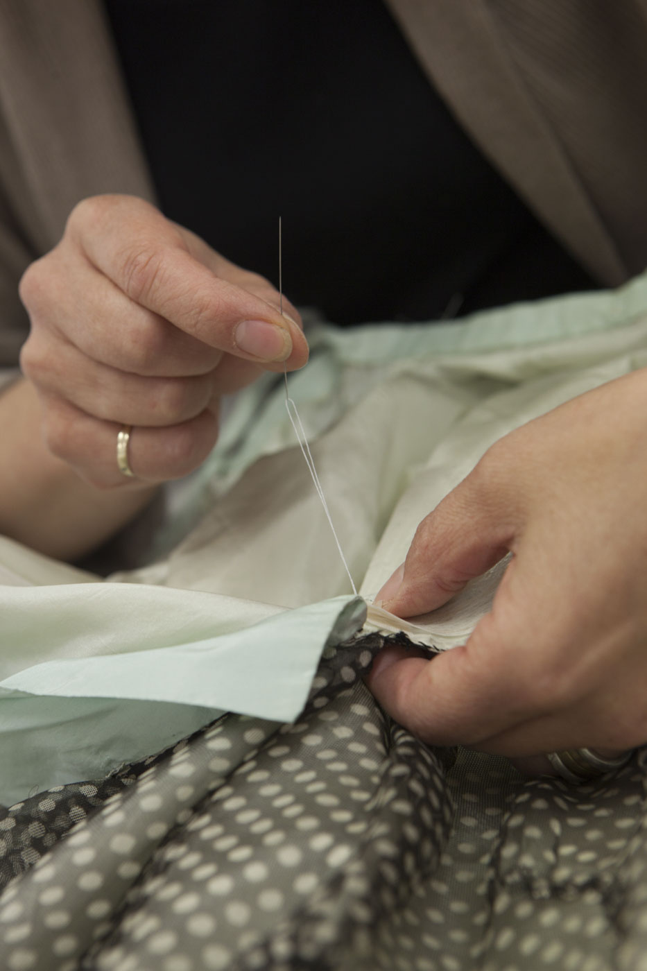 Conservator stitching. - click to view larger image