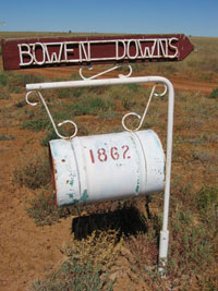 A roadside mailbox. The number on the box is 1862 and the sign above reads 'Bowen Downs'