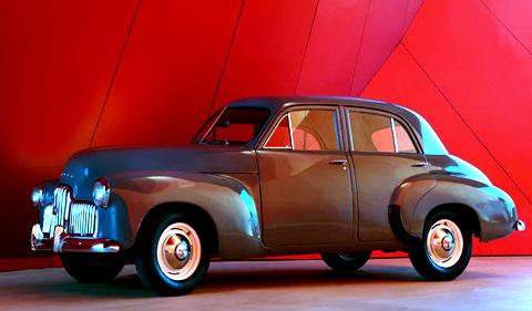 Essington Lewis Holden motorcar. Four door, medium grey sedan with chrome-plated radiator grille.