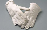 Detail of a pair of white gloves