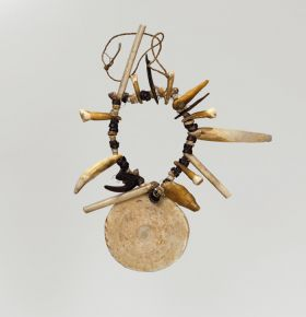 Necklace made from shell, coconut shell, tortoiseshell, bone and teeth.