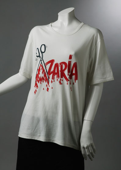 T-shirt with 'Azaria' written in red and the 'A' formed by an open pair of scissors.