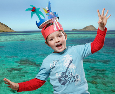 A young visitor wearing an island style headdress and standing in front of an image of the Torres Strait. Photo: George Serras.