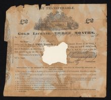 Photograph of a 'GOLD LICENSE' printed on paper, which has been folded and torn around the edges and has a section missing at the centre. A 'Colony of Victoria' coat of arms is centre top, wth text underneath.