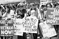 a black and white photo in the 1970s of a protest