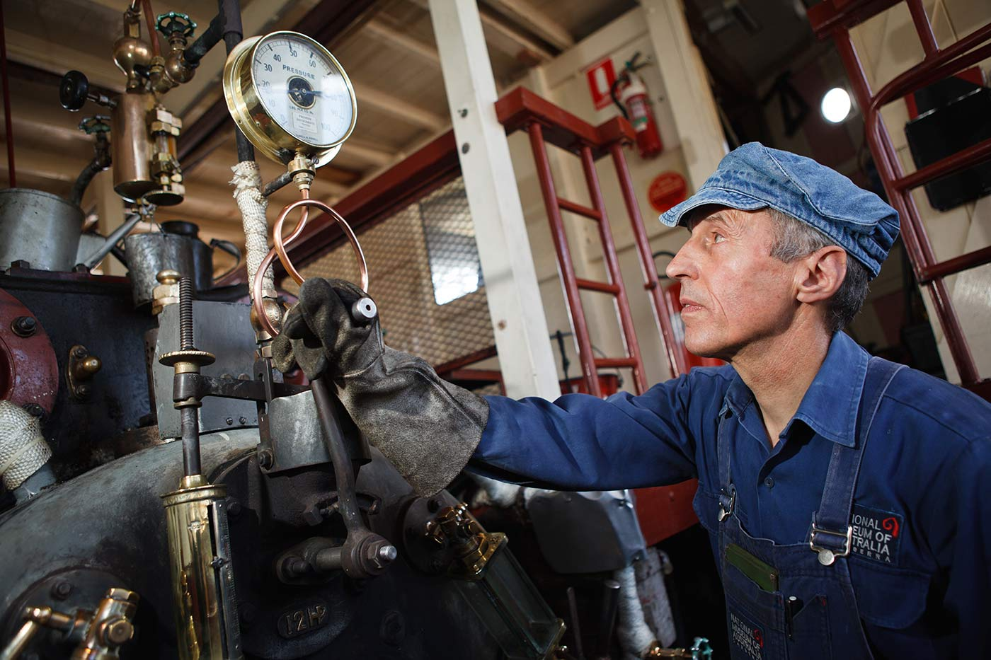 Engineer and volunteer Joe Johnson keeping the PS Enterprise steaming on Lake Burley Griffin.