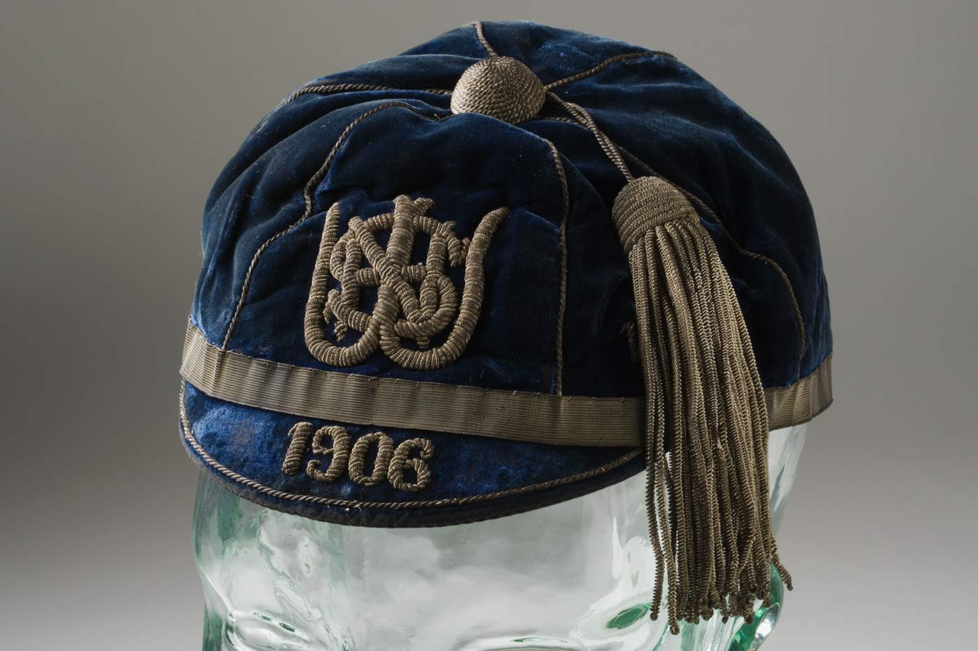 Blue velvet cap with silver tassela nd '1906' embroidered in silver yarn on the small peak. - click to view larger image
