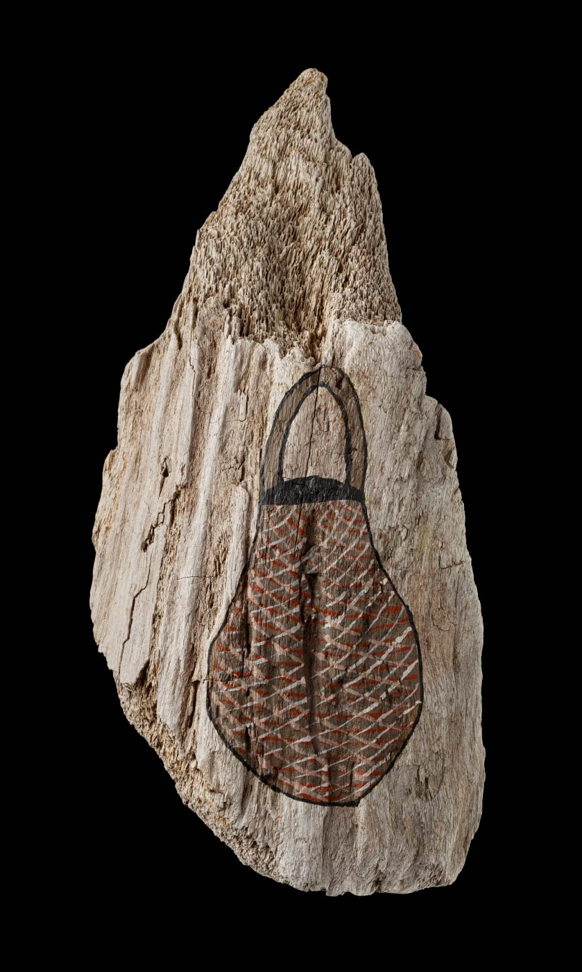 An acrylic painting on driftwood featuring a bag with crosshatching in red, beige and light brown. - click to view larger image