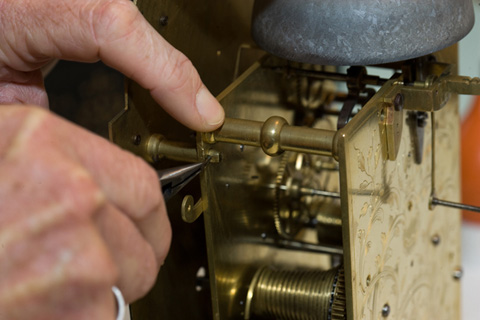 A small pin is positioned to the movement pillar to secure the dial.