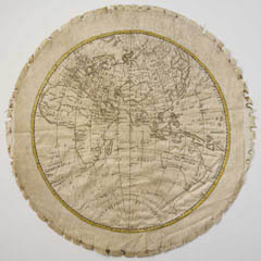 Embroidered map sampler of the Eastern hemisphere of the world as it was understood by Europeans at the end of the 1700s