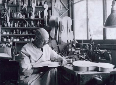 AE Smith in his workshop at home, about 1954.