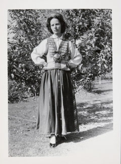 Guna Kinne wearing the dress outside her Wangaratta home in 1955. Photo: National Museum of Australia.