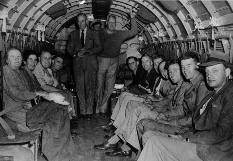 Expedition members aboard the RAAF Dakota aircraft travelling from Adelaide to Darwin, March 1948.