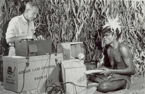 CP Mountford recording ceremonial song with Hindoo Namunduwulmul Mirniyowan at the 1948 Groote Eylandt expedition camp. Details of the neck pendant have been digitally obscured, in deference to customary law.