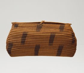 Basket made of sticks from the coconut palm leaf, wrapped up with coconut fibre strings, and connected with the same material.