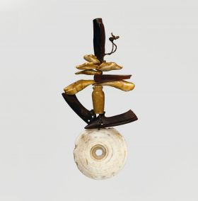 Pendant consisting of a number of elements such as bone, fish teeth and pieces of tortoiseshell tied on a string. The lowest element is a white, perforated shell disc.