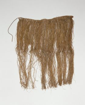 Skirt or apron made from fine shred of plantain leaf, dyed and knotted to a string that fastens around the waist.