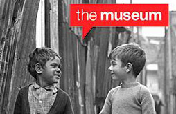 Black and white image of two young boys under a speech bubble that reads 'the museum