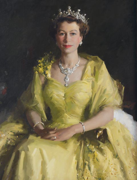 Portrait of Queen Elizabeth II, seated, and wearing a gold-coloured dress. Her hands and folded on her lap and she also wears a tiara, necklace and bracelets.