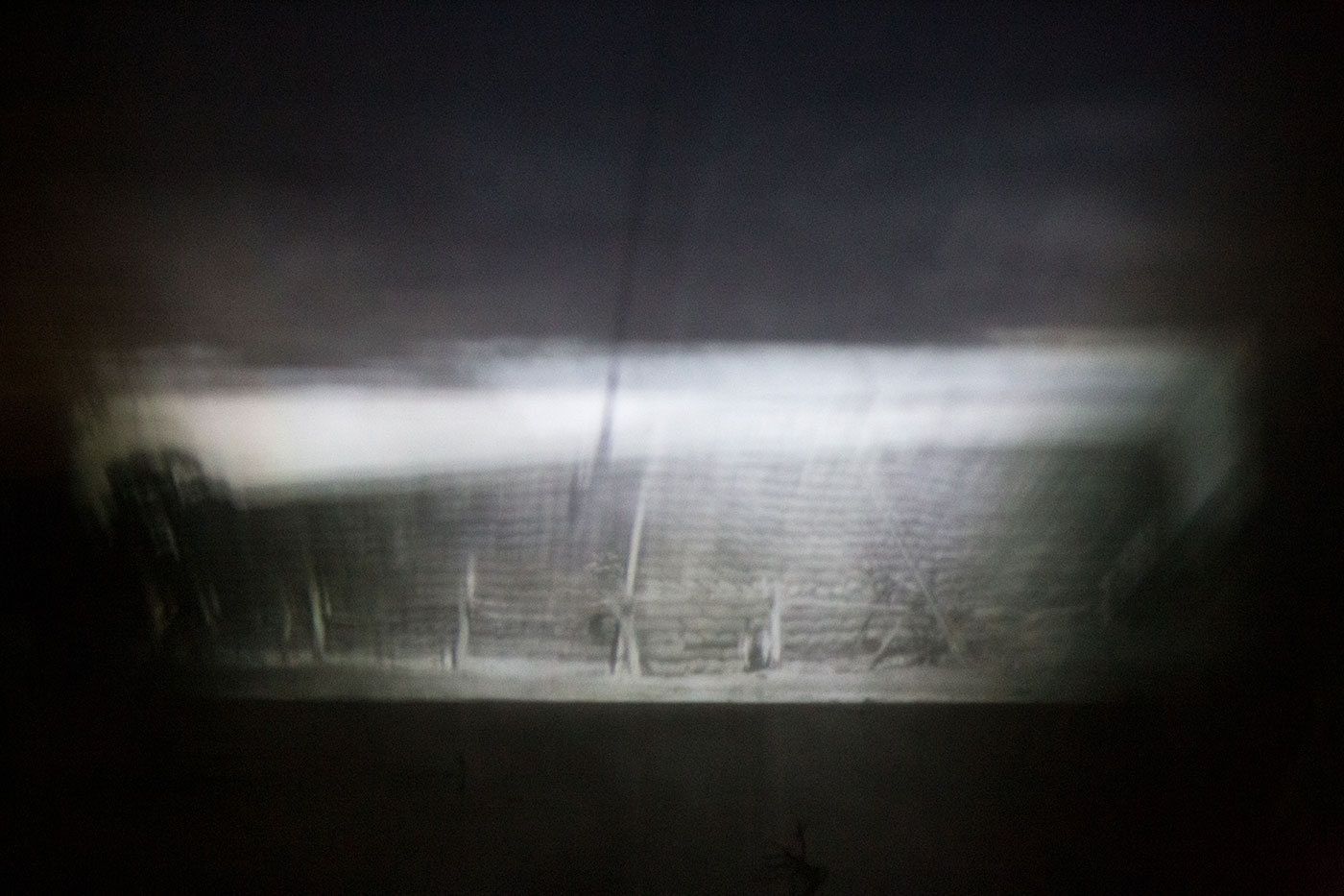 An image of a stack of wheat bags awaiting rail transport at Temora (about 1920) projected onto fog - click to view larger image