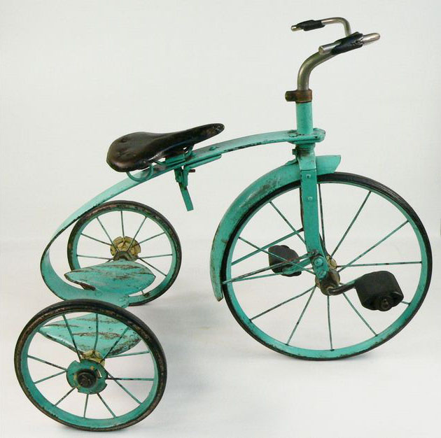 A metal, pale green-painted child's tricycle with black hand-grips and pedals and a black leather seat. - click to view larger image