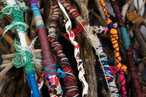 Sticks covered in colourful fabrics.