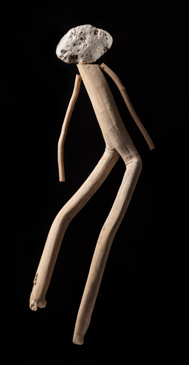 A figurative artwork made from driftwood, pumice stone and copper wire. - click to view larger image