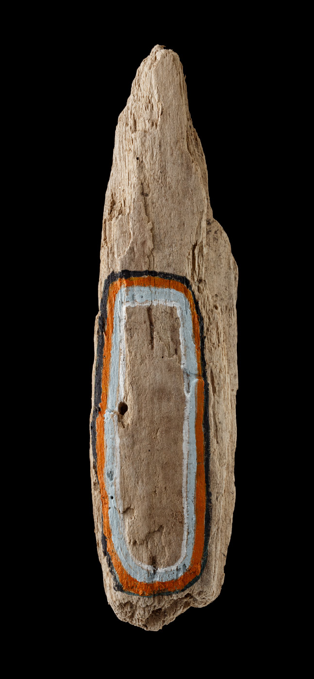 An acrylic painting on driftwood featuring a almost concentric oval made of black, orange, blue and white lines. - click to view larger image