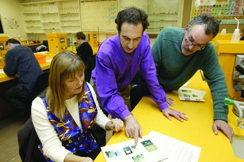 The Museum's Roger Garland (centre) teaches Museum Studies to students at the Canberra Institute of Technology
