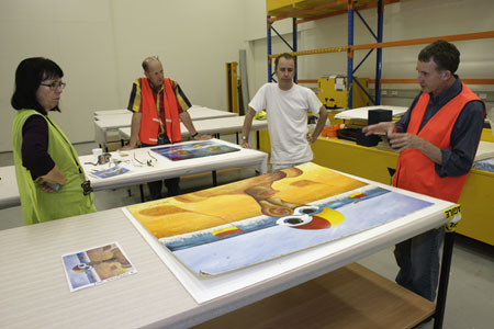 Registration manager Carol Cooper, Museum conservators Peter Bucke and David Parker discuss the triage operation with Conservation Manager Eric Archer.