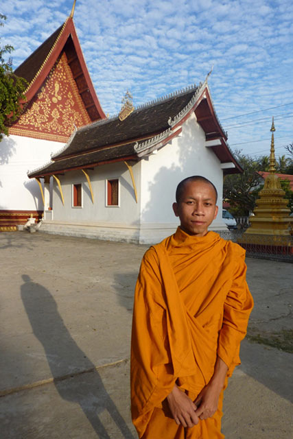 Monk Vanna standing in front of his temple prior to prayer time.