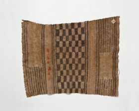 Apron made of plant fibre and hand-woven into fine netting that forms a stripe and chequered pattern.