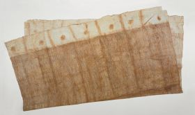 Large piece of glazed barkcloth decorated with a pattern of diagonal and vertical brown lines with a white border and large brown spots and stripes at both ends.