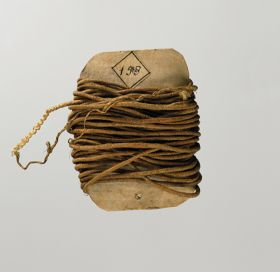 Cord made of twisted flax and wrapped around a card.