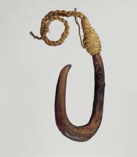 U-shaped fishhook made from a piece of hardwood made secure with cord.