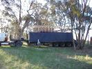 A colour photograph of the wagon in place on the back of the transport truck which is covered by tarpaulins.