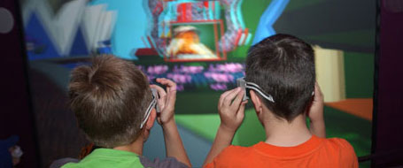 Back view of two boys wearing 3D glasses.